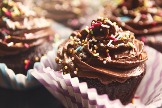 Delicious chocolate cupcake with whipped and sprinkle on the top