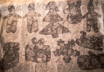 Papiers peints Vieux mur texturé sale gingerbread on baking sheet. stains from Christmas cookies on a baking paper