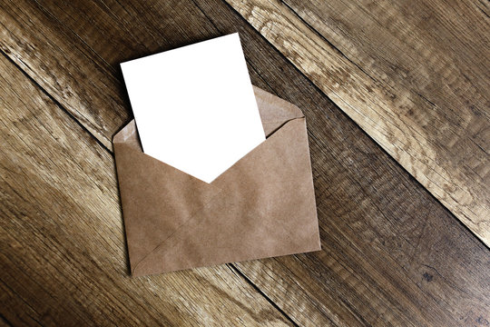 greeting card.Blank card and envelope on old wooden background