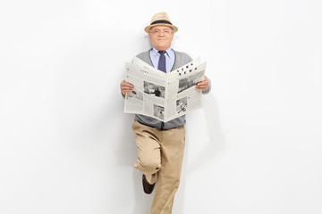 Senior gentleman holding a newspaper