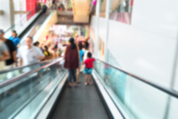 Blurred moving escalator with people for background