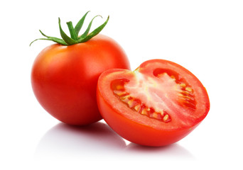 Red tomatoes with cut isolated on white