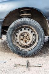 Rusty car wheel with a special key
