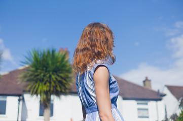 Young woman standing in garden