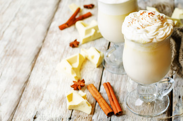 hot white chocolate decorated with whipped cream with cinnamon