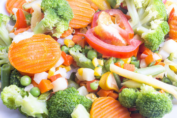 lots of salad of boiled vegetables with tomato very close