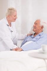 Nurse taking care about patient