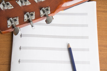 guitar notebook and pencil