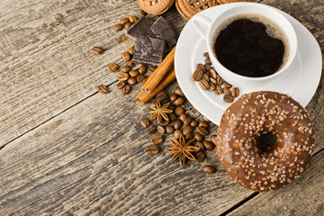 coffee and cookies on wood background
