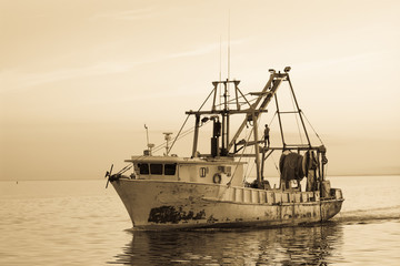Fishing boat off coast of Florida.  Vintage artistic filters applied.