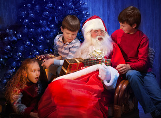 Classic Santa giving Christmas Presents to Happy Children.