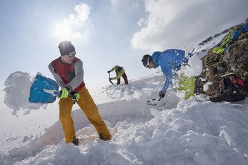 Men shovelling snow for bivouac camp, Tyrol, Austria