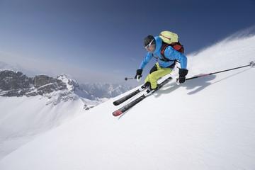 Young man skiing, Rofan, Tyrol, Austria