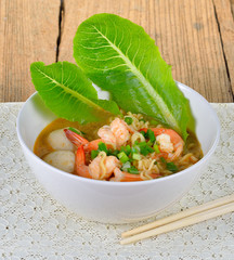 Hot and spicy instant noodle with shrimp and vegetable