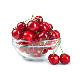 glass bowl with cherries isolated on white background