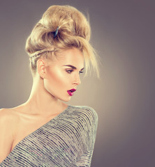High fashion model girl portrait with updo hairstyle