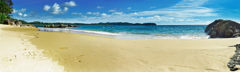 Beach panorama at Phanga Thailand with blue sky.