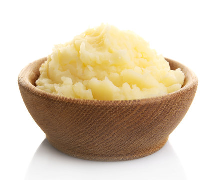 Mashed potatoes in wooden bowl isolated on white