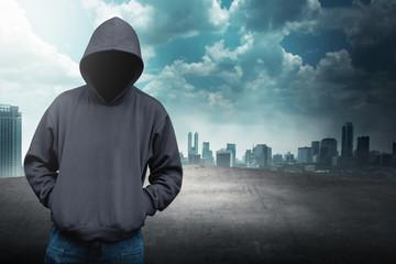 Faceless man in hood on the rooftop - fototapety na wymiar
