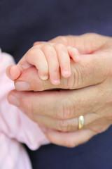 Newborn Baby Girl Holding Grandpa's Hand