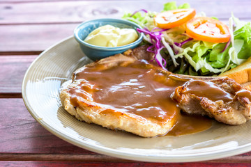 pork steak and vegetable salad