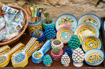 Various decorated ceramic objects for sale outside a souvenir shop in Erice, Sicily