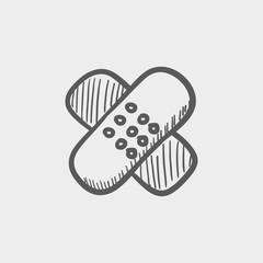 Adhesive bandages sketch icon