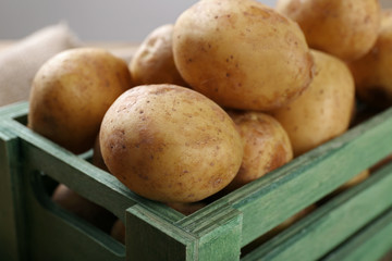 Young potatoes in crate close up
