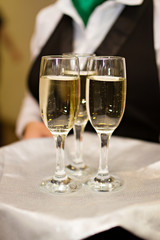 Three glasses of Champagne and a waiter
