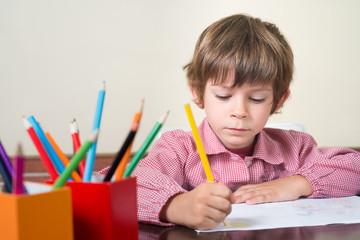 school child drawing in school