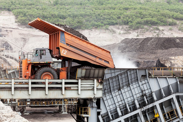 Truck pouring lignite coal to a degradation in mine.