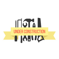 under construction on yellow ribbon with black tools