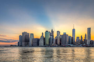 Wall Mural - New York City downtown skyline in beautiful sunset