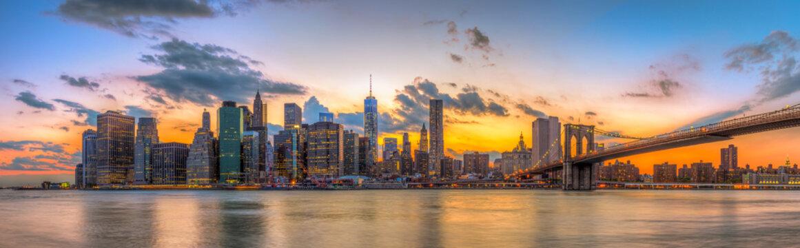 Brooklyn bridge and downtown New York City in beautiful sunset