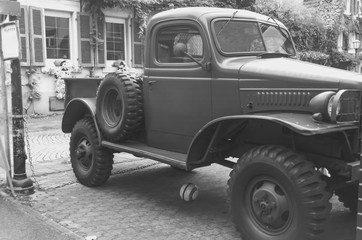 Vintage trucks. Soccer ball rolled under the truck.