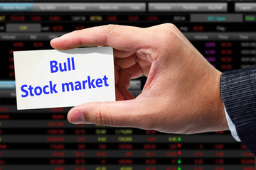 Hand writing Bull stock market message.