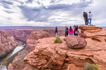 PAGE, ARIZONA - MAY 25: Hikers at Horseshoe Bend on May 25, 2015