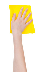 hand with yellow washing rag isolated on white