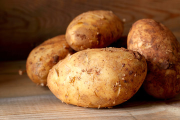 Potatoes. Potatoes on a wooden surface.