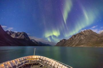 The aurora borealis in Kangerlussuaq Fjord, Greenland, Polar Regions