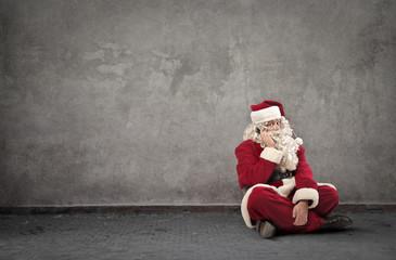 Santa Claus sitting doing a phone call