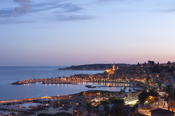 A cityscape of Menton at dusk, Provence-Alpes-Cote d'Azur, French Riviera, France, Mediterranean, Europe
