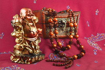 statuette of Buddha, casket, beads made of wood
