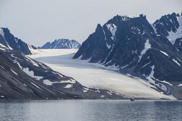 Little fishing boat in Magdalenen Fjord, Svalbard, Arctic, Norway, Scandinavia, Europe