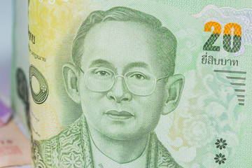 Close up of thailand currency, thai baht with the images of Thailand King. Denomination of 20 bahts.