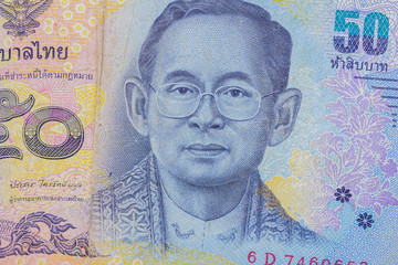 Close up of thailand currency, thai baht with the images of Thailand King. Denomination of 50 bahts.