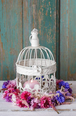 Cornflower wreath and vintage birdcage