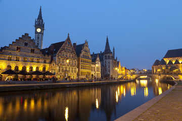 Buildings lit up at night along the Graslei, a Medieval Port in the Historic Center of Ghent, Belgium, Europe