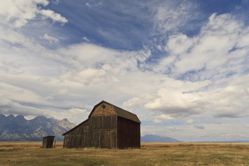 Mormon Row barn under a big sky in autumn (fall), Antelope Flats, Grand Teton National Park, Wyoming, United States of America, North America