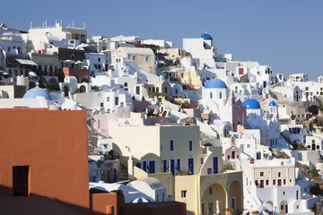 Coloured houses and church with blue dome in the evening light, Oia, Santorini, Cyclades, Aegean Sea, Greek Islands, Greece, Europe